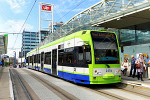 Croydon, United Kingdom - August 29, 2015: The East Croydon Railway Station provides an accessible interchange between Tramlink trams (light rail) and metro trains with CBD and airport connections. Tramlink (owned by Transport For London, TfL) is an 18½-mile light rail/tram network serving Croydon and surrounding areas in South London with links to Wimbledon, Beckenham, Elmers End and New Addington.  Some of the network runs on former railway lines.