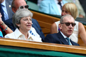 Tennis - Wimbledon - All England Lawn Tennis and Croquet Club, London, Britain - July 13, 2019  Britain's Prime Minister Theresa May with her husband, Philip May, in the Royal Box ahead of the final between Serena Williams of the U.S. and Romania's Simona Halep  REUTERS/Hannah McKay