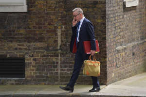 Britain's Environment, Food and Rural Affairs Secretary Michael Gove speaks on the phone after attending a cabinet meeting at Downing street in central London on June 18, 2019. (Photo by Daniel LEAL-OLIVAS / AFP)        (Photo credit should read DANIEL LEAL-OLIVAS/AFP/Getty Images)