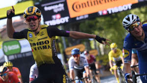 Belgium's Wout van Aert (L) celebrates, past Italy's Elia Viviani, as he wins on the finish line of the tenth stage of the 106th edition of the Tour de France cycling race between Saint-Flour and Albi, on July 15, 2019. (Photo by Anne-Christine POUJOULAT / AFP)        (Photo credit should read ANNE-CHRISTINE POUJOULAT/AFP/Getty Images)