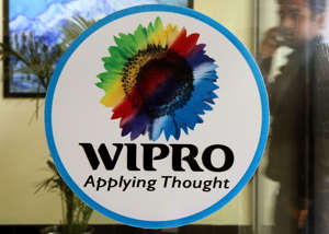An Indian Software Professionals Walks Infront of the Wipro Logo at the Wipro Campus in Bangalore India 18 January 2015 India's Third-largest Software Services Exporter Wipro Ltd Posted a Two Per Cent Growth in Quarterly Net Profit India Bangalore