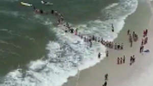 Good Samaritans form human chain to save struggling swimmers