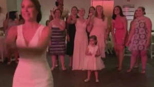 Watch: Wedding's flower girl expertly catches bride's bouquet