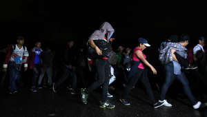 Honduran migrants, part of the second caravan to the United States, leave San Pedro Sula, 180 km north of Tegucigalpa, on January 14, 2019. - President Donald Trump is threatening to declare a national emergency as he pressures Congress for money to build a wall on the US-Mexican border to stem a surge in illegal immigrants. Many migrants -who arrive as families or unaccompanied children, hoping to gain a foothold in the country- when caught, most are processed by the authorities, then released pending a court date, and  authorities say they are mostly never seen again as they meld into US society. (Photo by ORLANDO SIERRA / AFP)        (Photo credit should read ORLANDO SIERRA/AFP/Getty Images)