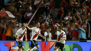 River Plate's Gonzalo Martinez, center, celebrates scoring against Boca Juniors during the Supercopa Argentina final match in Mendoza, Argentina, Wednesday, March 14, 2018.(AP Photo/Marcelo Ruiz)