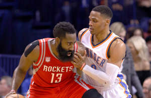 FILE - In this Dec. 9, 2016, file photo, Houston Rockets guard James Harden (13) is defended by Oklahoma City Thunder guard Russell Westbrook (0) on a drive to the basket during the second half of an NBA basketball game in Oklahoma City. The Rockets and the Thunder will meet on Christmas Day, Monday, Dec. 25, 2017. (AP Photo/Alonzo Adams, File)