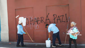 "SAN JUAN, PUERTO RICO - JULY 18: Workers cover up graffiti that translates to, 'Ricky, there will be no peace,' as protesters tagged buildings announcing their displeasure with Ricardo ""Ricky"" Rossello, the Governor of Puerto Rico on July 18, 2019 in Old San Juan, Puerto Rico. There have been calls for the Governor to step down after it was revealed that he and top aides were part of a private chat group that contained misogynistic and homophobic messages. (Photo by Joe Raedle/Getty Images)"