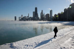 CHICAGO, ILLINOIS - JANUARY 30: A man takes a walk along the city's lakefront as temperature hung around -20 degrees on January 30, 2019 in Chicago, Illinois. Businesses and schools have closed, Amtrak has suspended service into the city, more than a thousand flights have been cancelled and mail delivery has been suspended as the city copes with record-setting low temperatures.  (Photo by Scott Olson/Getty Images)