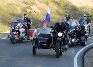 Russian President Vladimir Putin rides a bike before the Babylon's Shadow bike show in Sevastopol, Crimea on August 10, 2019. (Photo by Alexei Druzhinin / Sputnik / AFP) (Photo credit should read ALEXEI DRUZHININ/AFP/Getty Images)