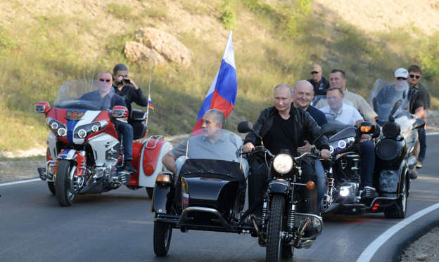 Slide 1 of 56: Russian President Vladimir Putin rides a bike before the Babylon's Shadow bike show in Sevastopol, Crimea on August 10, 2019. (Photo by Alexei Druzhinin / Sputnik / AFP) (Photo credit should read ALEXEI DRUZHININ/AFP/Getty Images)