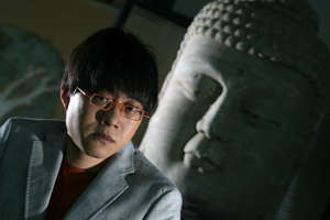 Photo of Canto-pop lyricist Lin Xi who talk about his new design project and involvement in multi-media production Hua-Yen Sutra, pictured at his home, Mid-levels.  28 MAY 2007 (Photo by Felix Wong/South China Morning Post via Getty Images)