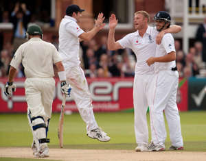 England's Andrew Flintoff (centre) celebrates dismissing Australia's Mike Hussey with teammates Alastair Cook (right) and James Anderson during the second day of the second npower Test match at Lord's, London.   (Photo by Gareth Copley/PA Images via Getty Images)