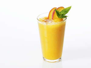a glass of orange juice: Just Peachy