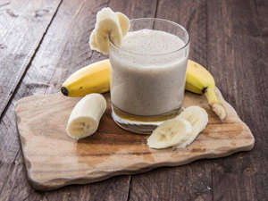 a banana sitting on top of a wooden table: 30 Healthy Smoothies For Breakfast On-the-Go