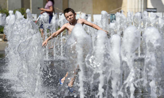 Slide 1 of 50: A boy plays in a fountain in the downtown of Budapest, Hungary, on Aug. 12. For some regions of the country even the highest grade of warning has been issued by the National Meteorological Service as the temperatures may reach 33-38 degrees Celsius in Hungary.
