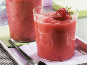 a glass of orange juice: Berry Good Workout Smoothie