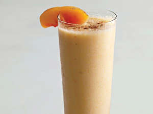 a close up of a beverage in a cup: Sunrise Smoothie