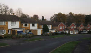A row of houses on a curved street in suburbia.