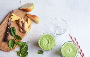 a close up of food on a table: pear spinach smoothie
