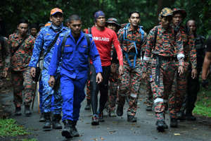 Members of a rescue team walk to Mount Berembun as they take part in a search effort to locate missing 15-year-old Franco-Irish teenager Nora Quoirin in Seremban on August 12, 2019. - Nora Quoirin, a 15-year-old with learning difficulties, disappeared on August 4, a day after checking into a Malaysian resort with her London-based family. (Photo by Mohd RASFAN / AFP)        (Photo credit should read MOHD RASFAN/AFP/Getty Images)