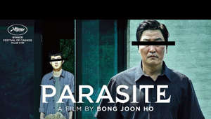 "a man holding a sign: Act like you own the place. #Parasite is in US Theaters October 11.   Bong Joon Ho brings his singular mastery home to Korea in this pitch-black modern fairytale.  Meet the Park Family: the picture of aspirational wealth. And the Kim Family, rich in street smarts but not much else. Be it chance or fate, these two houses are brought together and the Kims sense a golden opportunity. Masterminded by college-aged Ki-woo, the Kim children expediently install themselves as tutor and art therapist, to the Parks. Soon, a symbiotic relationship forms between the two families. The Kims provide ""indispensable"" luxury services while the Parks obliviously bankroll their entire household. When a parasitic interloper threatens the Kims' newfound comfort, a savage, underhanded battle for dominance breaks out, threatening to destroy the fragile ecosystem between the Kims and the Parks.  By turns darkly hilarious and heart-wrenching, PARASITE showcases a modern master at the top of his game."