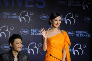 "Chinese actress Li Feier and Chinese actor Zi Yi  attend the press conference of the film ""Rizhao Chongqing"" (Chongqing Blues) presented in competition at the 63rd Cannes Film Festival on May 13, 2010 in Cannes.  AFP PHOTO / ANNE-CHRISTINE POUJOULAT (Photo credit should read ANNE-CHRISTINE POUJOULAT/AFP/Getty Images)"
