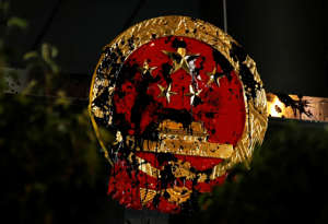 The National Emblem of the People's Republic of China is seen vandalised on the Chinese Liaison Office after a march to call for democratic reforms, in Hong Kong, China July 21, 2019. Picture taken July 21, 2019.