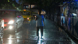 KOLKATA, WEST BENGAL, INDIA - 2019/08/07: A man walks down the street with an umbrella during a rainy night in Kolkata. Gangetic West Bengal, the major part of Kolkata at present is the most rain deficient region of the country with a deficiency of 47%. (Photo by Avijit Ghosh/SOPA Images/LightRocket via Getty Images)