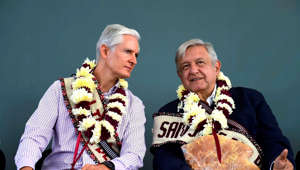 In this handout photo provided by Mexico's Presidential Press Office, Mexico's state Gov. Alfredo del Mazo, left, accompanies Mexico's President Andres Manuel Lopez Obrador during a dialogue with the community of the rural hospital in San Jose del Rincon, Mexico, Saturday, Aug. 3, 2019. (Mexico's Presidential Press Office via AP)