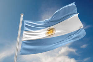 Argentinian flag is waving at a beautiful and peaceful sky in day time while sun is shining.