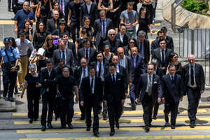 Lawyers and members of the election committee's legal sector hold a silent march against what they claim is political persecution by the Secretary for Justice, and demanding an independent inquiry into the anti-extradition law crisis, in Hong Kong on August 7, 2019. - Hong Kong has been plunged into its worst crisis in recent history after millions of demonstrators took to the streets, triggered by a controversial bill which would have allowed extraditions to mainland China but have evolved into a call for wider democratic reforms. (Photo by Philip FONG / AFP)        (Photo credit should read PHILIP FONG/AFP/Getty Images)