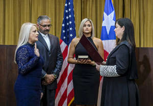 Justice Secretary Wanda Vazquez is sworn in as governor of Puerto Rico by Supreme Court Justice Maite Oronoz, in San Juan, Puerto Rico, Wednesday, Aug. 7, 2019. Vazquez took the oath of office early Wednesday evening at the Puerto Rican Supreme Court, which earlier in the day ruled that Pedro Pierluisi's swearing in last week was unconstitutional. Vazquez was joined by her daughter Beatriz Diaz Vazquez and her husband Judge Jorge Diaz.