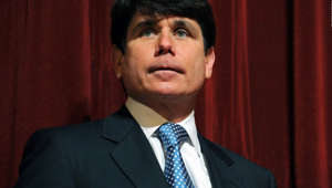 Rod Blagojevich wearing a suit and tie: This February 15, 2008 file photo shows then Illinois Governor Rod Blagojevich at a press conference at Northern Illinois University in DeKalb, Illinois. Blagojevich was convicted on June 27, 2011 of 17 of the 20 charges against him, including all 11 charges related to his attempt to sell or trade President Barack Obama's vacated Senate seat. The jury found him not guilty of soliciting bribes in the alleged shakedown of a road-building executive. The panel deadlocked on a charge of attempted extortion on that same case.