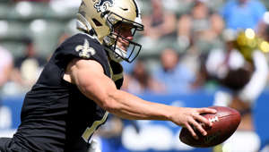 CARSON, CALIFORNIA - AUGUST 18: Taysom Hill #7 of the New Orleans Saints fakes a hand off in a 19-17 Saints win over the New Orleans Saints during a preseason game at Dignity Health Sports Park on August 18, 2019 in Carson, California. (Photo by Harry How/Getty Images)