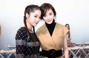 NEW YORK, NY - SEPTEMBER 13: Oyang Nana & Yang Mi attend the Michael Kors runway show during New York Fashion Week at Spring Studios on September 13, 2017 in New York City. (Photo by Edi Chen/Getty Images for Michael Kors)