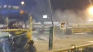 Runaway bus barrels into fence, narrowly missing large Indiana crowd