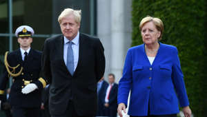 Britain's Prime Minister Boris Johnson walks with German Chancellor Angela Merkel at the Chancellery in Berlin, Germany August 21, 2019. REUTERS/Annegret Hilse