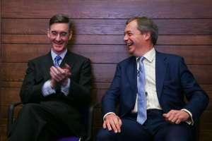 Brexit Party leader Nigel Farage (R) sits next to Conservative Party MP and chairman of the European Research Group (ERG) Jacob Rees-Mogg (L)