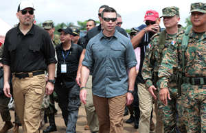 Acting U.S. Secretary of Homeland Security Kevin McAleenan walks with Panamanian soldiers during his visits at a temporary shelter for migrants in the village of La Penita, Panama  August 23, 2019. REUTERS/Erick Marciscano