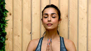 Indian Bollywood actress Malaika Arora performs yoga poses during the International Yoga Day at her studio in Mumbai on June 21, 2019. - Indian Prime Minister Narendra Modi led the way for International Yoga Day on June 21, performing sun salutations and other flexible feats in a mass session with an estimated 30,000 other devotees of the discipline. (Photo by STR / AFP)        (Photo credit should read STR/AFP/Getty Images)