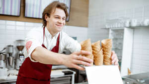 Salesman taking waffle cone while making ice cream for the client  (Picture for representation)