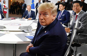 U.S. President Donald Trump attends the first working session of the G7 Summit, in Biarritz, France, August 25, 2019. Jeff J Mitchell/Pool via REUTERS