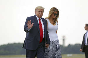 President Donald Trump and first lady Melania Trump walk to board Air Force One at Bordeaux–Mérignac Airport, Monday, Aug. 26, 2019 in Bordeaux, France, to return to Washington following the G-7 summit. (AP Photo/Andrew Harnik)