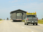 A tiny house still must go somewhere. Depending on distance and what's being towed, the cost of moving can run from the low hundreds to more than $10,000. To move home themselves, homeowners have to buy trailers for $4,000 to $7,000 to be towed by heavy-duty pickups with low gas mileage (even lower when pulling a whole house behind you). But even before you get on the trailer, you'll need to figure out other logistics …