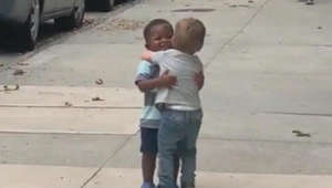 Watch 2 toddlers run to each other to share heartwarming hug