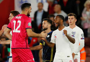 Soccer Football - Euro 2020 Qualifier - Group A - England v Kosovo - St Mary's Stadium, Southampton, Britain - September 10, 2019  Kosovo's Aro Muric shakes hands with England's Raheem Sterling after the match   Action Images via Reuters/Andrew Boyers