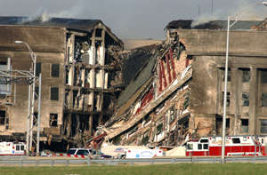 394422 04: A 200-foot gash exposes interior sections of the Pentagon following a suspected terrorist crash of a hijacked commercial airliner into the Pentagon September 11, 2001 in Arlington, VA. The attack came at approximately 9:40 a.m. as the plane, originating from Washington D.C.''s Dulles airport, was flown into the southern side of the building. (Photo by Bob Houlihan/U.S. Navy/Getty Images)