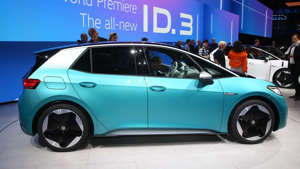 a blue car parked in front of a building: Volkswagen ID.3: Frankfurt 2019