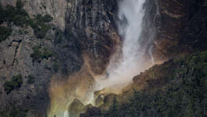 YOSEMITE VALLEY, CA - JULY 01:  The iconic Bridalveil Fall is viewed from Tunnel View flowing at record levels on July 1, 2019, in Yosemite Valley, California. With record winter and spring snowfall covering much of California's Sierra Nevada Mountain range, the water runoff into Yosemite Valley and the Merced River has been heavy, or at flood stage, creating spectacular waterfalls. (Photo by George Rose/Getty Images)