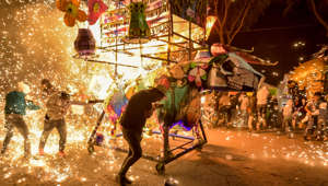 08 March 2019, Mexico, Tultepec: A cardboard bull filled with fireworks is ignited. Around the 8th of March, in Tultepec, the festival is celebrated in honour of San Juan de Dios, the patron saint of fireworks. Groups of homemade papier-mâché bull figures roam the streets filled with fireworks - a competition for the most beautiful bull. The figures are then ignited on the city promenade. Photo: Edgar Santiago Garcia/dpa (Photo by Edgar Santiago Garcia/picture alliance via Getty Images)